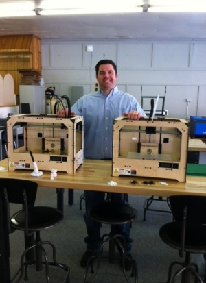 Matthew Wade and his donated MakerBots